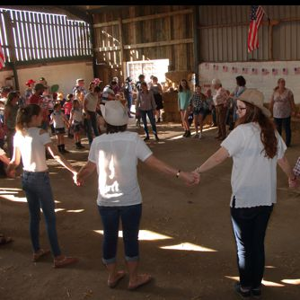 Dancers in a circle at a Hoedown